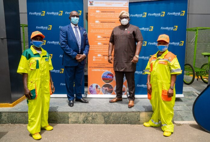 Sanwo-Olu gives uniforms to LAWMA sweepers, branded by First Bank